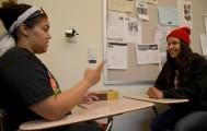 American Sign Language students Janessa Rocha and Mary Peterson must silently communicate April 8 during a SILA 305 sign language conversation quiz. Elizabeth Ramirez | Staff Photographer | elizabethramirezexpress@gmail.com
