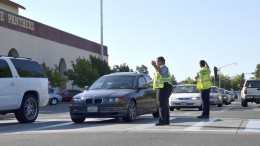 City College campus patrol officers Lakea Iliili and Jairo Gutierrez direct traffic Aug. 26 between the Child Development Center and Hughes Stadium. Elizabeth Ramirez|Staff Photographer|elizabethramirezexpress@gmail.com