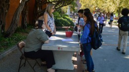 City College foundation workers, Ann Love (left) and Rachel Larsen (right),  converse with students about information regarding scholarship requirements outside of the City Cafe. Emily Foley | Staff Photogrpaher | emmajfoley@gmail.com