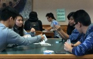 "City College students Hoi Luc, business major, Nancy Vang, nursing major, Amanda Yehya and Ken San play a card game called ""Duces"" while they wait for class to start.  Alina Castillo