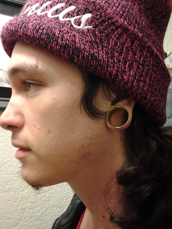 City College student Michael Lewis shows-off his 1-inch tunnels. Photo by Sierra Popp // Staff Writer // sierrapoppexpress@gmail.com