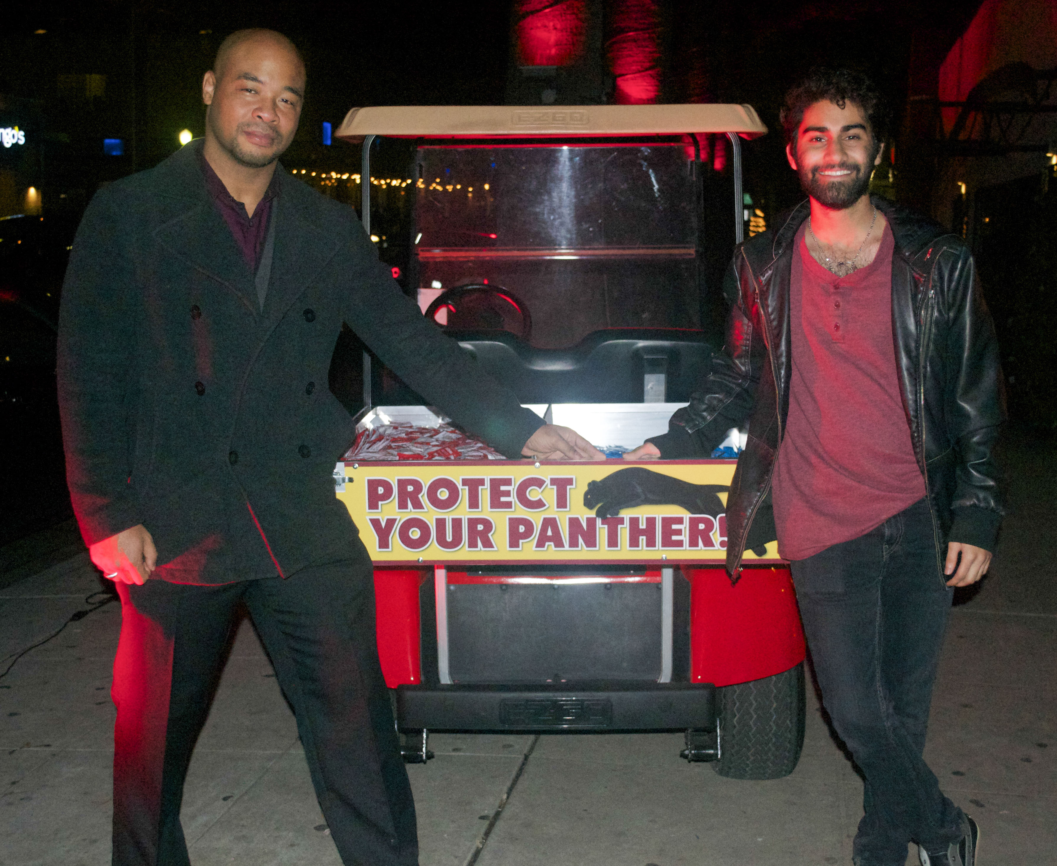 Lincoln Scott and Sandeep Singh of the Student Associated Council stand by the safe-sex golf cart, which is designed to help raise awareness about AIDS/HIV protection. Photo by Gabrielle Smith | Photo Editor | gsmithexpress@gmail.com