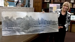 City College Special Collections Librarian Caroline Harker with an early photo of the campus. Photo by Penelope Kahn