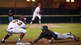 Brandon Langan, City College freshman first baseman, makes the catch to attempt a pickoff on Joe Garabedian, Fresno City College sophomore infielder, in top of the seventh at Union Stadium.