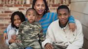 Ursula Yost-Johnson with three of her four children. Photo by Vanessa S. Nelson | Staff Photographer