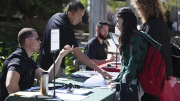 Enrollment Manager Jose A. Mejia speaks with City College Freshman XiaoXiao Yu, about transferring to CSU Sacramento at City's Transfer Day March 18, 2015. Vanessa Nelson | Staff Photographer