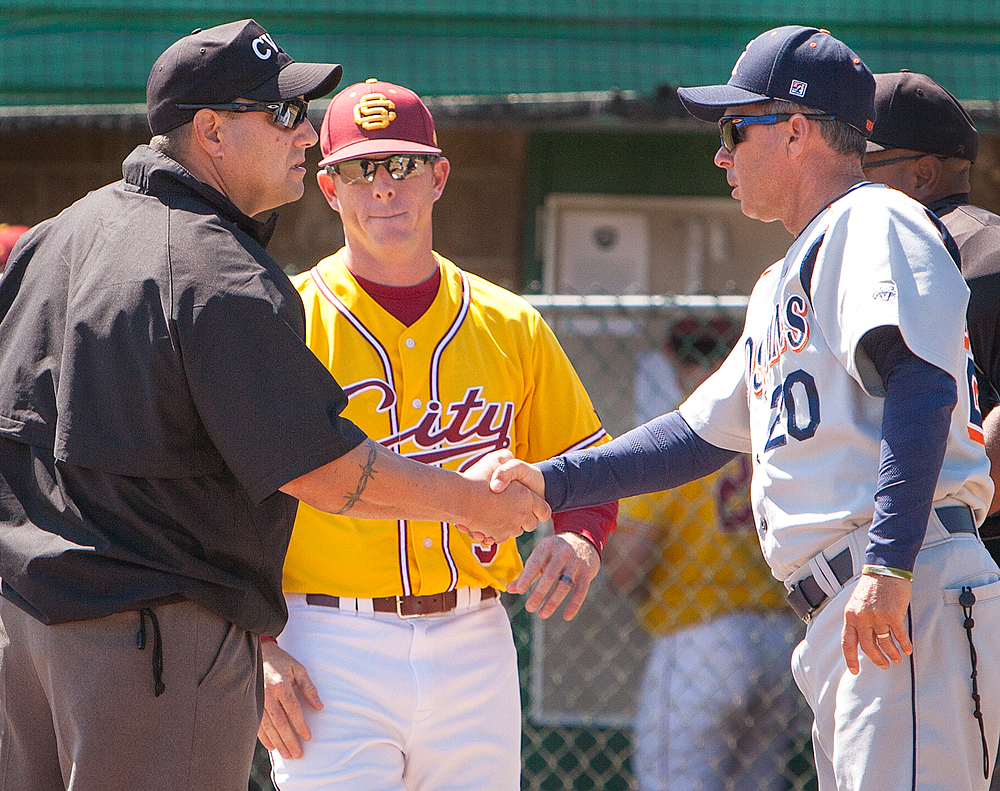 Gotlibe second base umpire shakes hands with Tony Bloomfield (right) head coach for Consumnes River College while City College head coach Derek Sullivan watches before the game at Union Stadium on April 14th.  Dianne Rose / dianne.rose.express@gmail.com