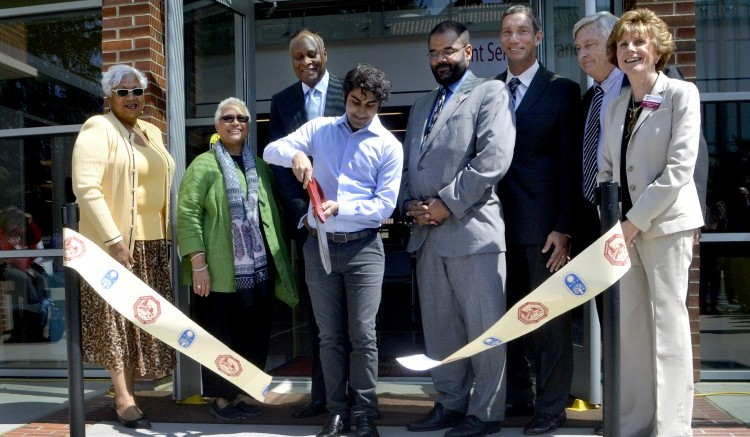 City College commemoration ceremony takes place today for the grand opening of the new student services, photography and journalism department May 8, 2015. President of the student senate, Sandeep Singh, cuts the ribbon to signify the official opening of the new building. Emily Foley | Photo Editor