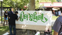City College students watch artist paint a mural in Sac City quad, May 5, 2015. Vhonn Ryan Encarnacion   Staff photographer   ryanvhonn@gmail.com