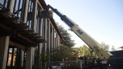 Construction workers use a cherry picker to lift dry wall to the third floor of Rodda North as construction on the building continues. Christopher Williams | Staff Photographer