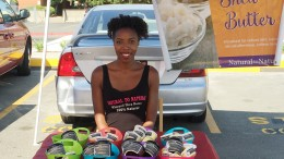City College student Ashley Turner, owner of Natural to Natural, sitting at the Farmers' Market Sunday Aug. 31, 2015 selling her all natural shea butter.