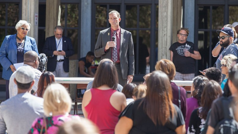 Los Rios Chancellor, Brian King, answers questions and concerns from students at the Love In on the quad at City College Sep. 5, 2015 after yeserdays fatal shooting on campus. Vanessa Nelson | Photo Editor | vanessanelsonexpress@gmail.com