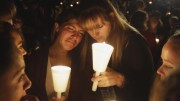 Kristen Sterner, left, and Carrissa Welding, both students of Umpqua Community College, embrace each other during a candle light vigil for those killed during a fatal shooting at the college, Thursday, Oct. 1, 2015, in Roseburg, Ore. (AP Photo/Rich Pedroncelli)