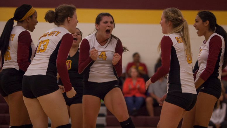 City College teammates react after winning the point in the third set in the match against Delta College in the North Gym on Sept. 30th.   Photos by Dianne Rose