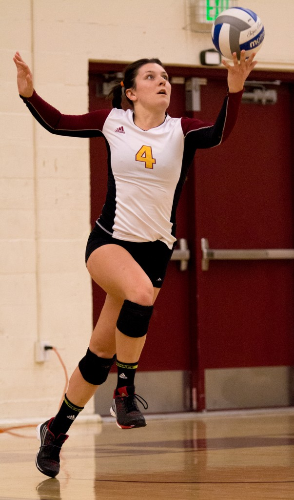 City College outside hitter Samantha Kepler lobs the ball up during her serve in the first set of the match against Modesto Junior College in the North Gym Nov. 3, 2015. (Photo: Kristopher Hooks   Editor in Chief   khooksexpress@gmail.com)