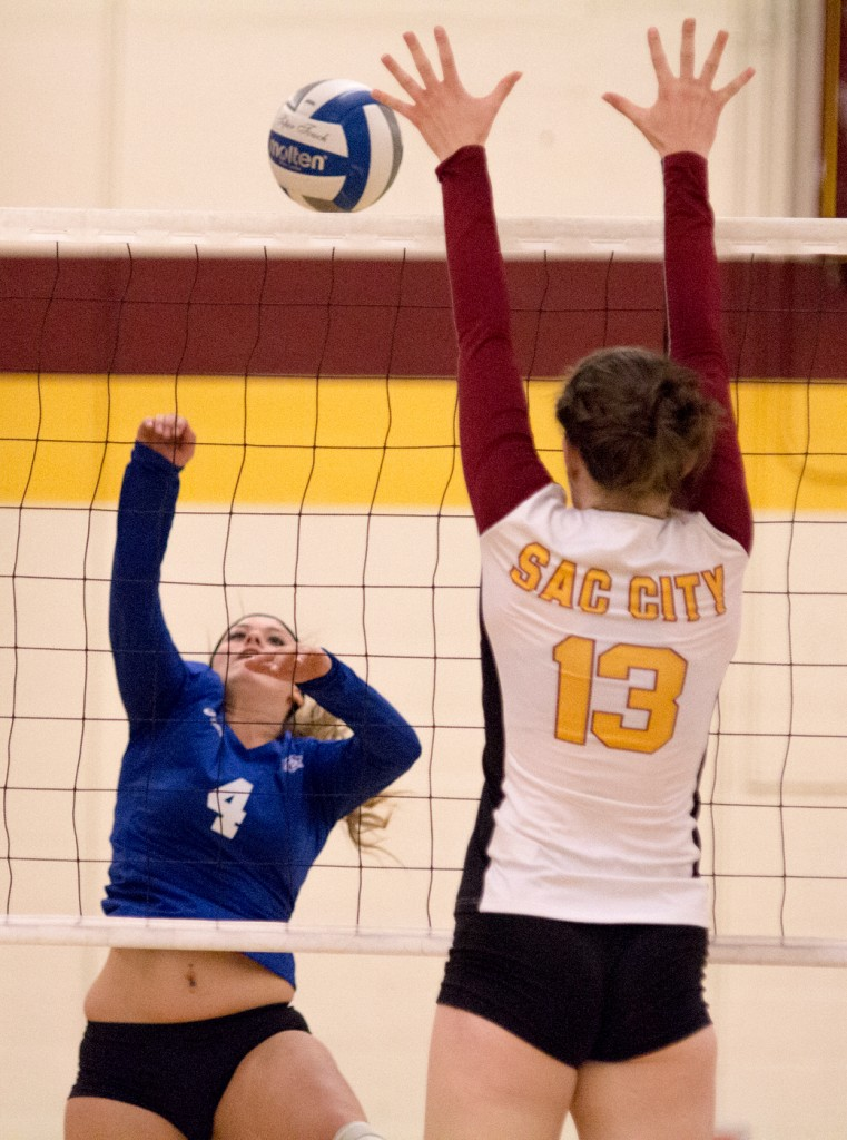 City College outside hitter Katie Haley goes up for the block during the second set of the match against Modesto Junior College in the North Gym Nov. 3, 2015. (Photo: Kristopher Hooks   Editor in Chief   khooksexpress@gmail.com)