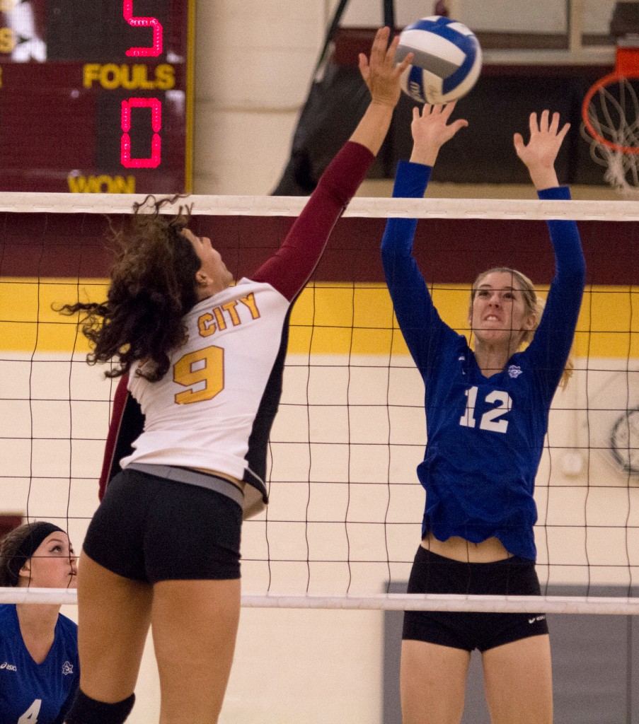 City College middle hitter Madyson Taylor hits the ball past a defender for a point during the second set of the match against Modesto Junior College in the North Gym Nov. 3, 2015. (Photo: Kristopher Hooks   Editor in Chief   khooksexpress@gmail.com)