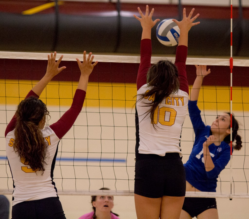 City College middle hitter Dorian Cox goes up for the block in the second set of the match against Modesto Junior College in the North Gym Nov. 3, 2015. (Photo: Kristopher Hooks   Editor in Chief   khooksexpress@gmail.com)