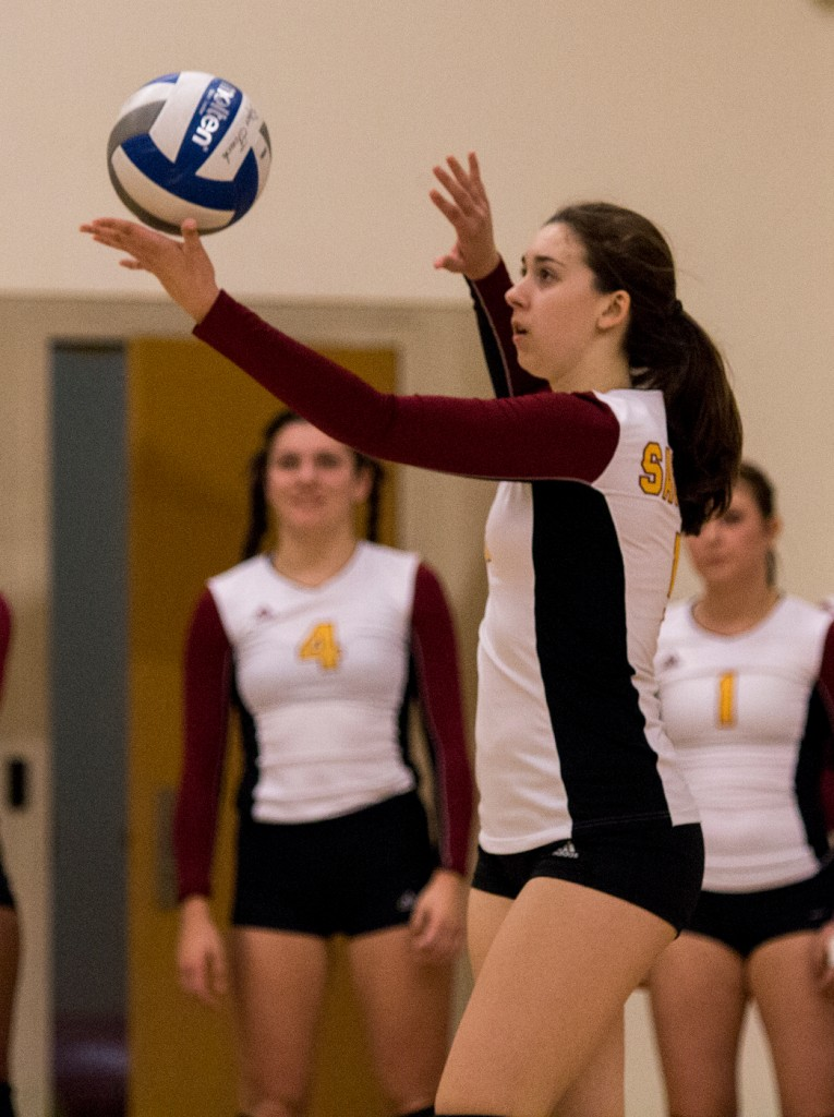 City College setter Kassidy Rauh lobs the ball up for the serve during the third set of the match against Modesto Junior College in the North Gym Nov. 3, 2015. (Photo: Kristopher Hooks   Editor in Chief   khooksexpress@gmail.com)