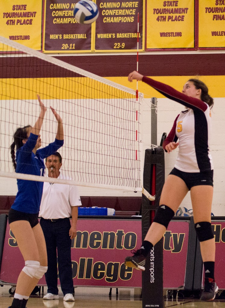 City College setter Kassidy Rauh tips the ball over the net after faking a pass during the third set of the match against Modesto Junior College in the North Gym Nov. 3, 2015. (Photo: Kristopher Hooks   Editor in Chief   khooksexpress@gmail.com)