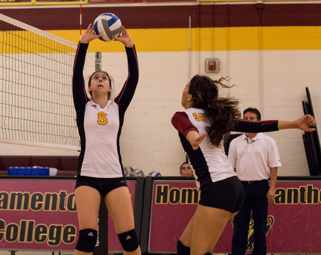 City College setter Kassidy Rauh sets the ball up for middle hitter Madyson Taylor during the third set of the match against Modesto Junior College in the North Gym Nov. 3, 2015. (Photo: Kristopher Hooks   Editor in Chief   khooksexpress@gmail.com)