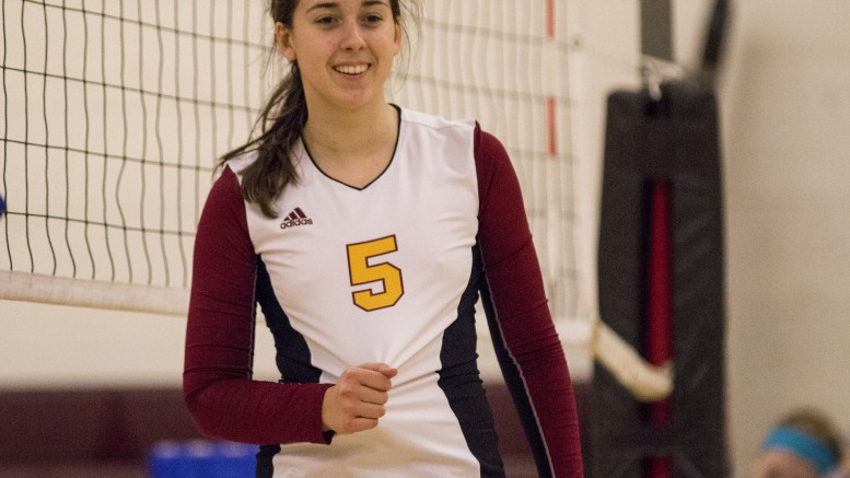 City College freshman setter Kassidy Rauh smiles at one of her teammates after the team scores a point during the match against Modesto Junior College in the North Gym Nov. 3, 2015. (Photo: Kristopher Hooks | Editor in Chief | khooksexpress@gmail.com)