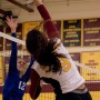 City College middle hitter Madyson Taylor spikes the ball past a defender during the second set of the match against Modesto Junior College in the North Gym Nov. 3, 2015. (Photo: Kristopher Hooks   Editor in Chief   khooksexpress@gmail.com)