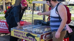Kj Duronslet and Michael Smith (left to right) help pass out condoms and candy to the student body near the City College cafe on November 3, 2015. Emily Peterson | staff photographer | emilypetersonexpress@gmail.com