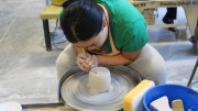City College student Samantha Hui, Psychology major, trimming her ceramic cup in Introduction Ceramics November 18, 2015. Photo by Julie Jorgensen   juliejorgensenexpress@gmail.com