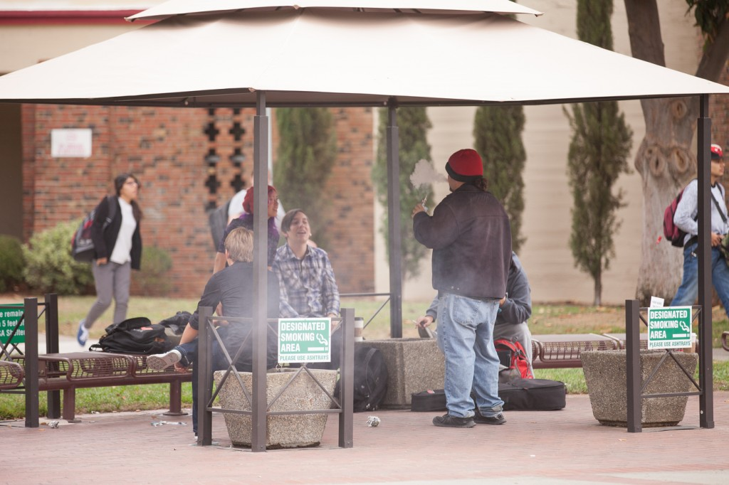 City College students gathered in the Designated Smoking Area provided for them on campus Oct. 27. Vanessa S. Nelson | Photo Editor | vanessanelsonexpress@gmail.com