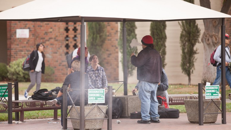 City College students gathered in the Designated Smoking Area provided for them on campus Oct. 27. Vanessa S. Nelson   Photo Editor   vanessanelsonexpress@gmail.com
