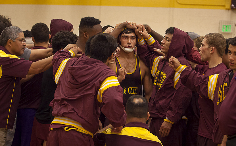 City Colleges Dylan Forzani gets the good luck touch from teammates before his match against Sierrra College at the North Gym Oct. 14. Photos by Dianne Rose