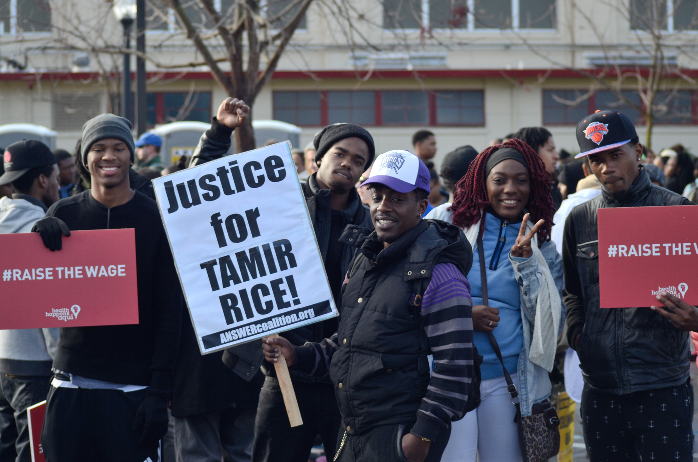 "MLK March 1-18-16 at City College. A group of people waits  for the walk to begin. While holding signs that say ""#raise the wage"" and ""Justice for Tamir Rice!""  Chris Williams, Staff Photographer. 