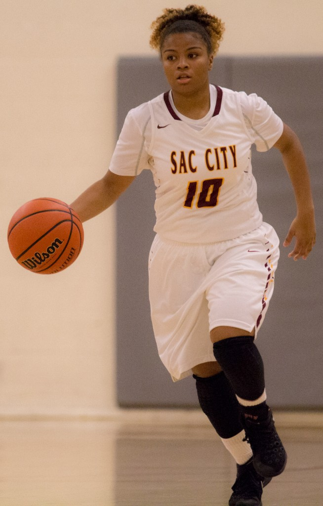 City College freshman point guard Mikaila Royster dribbles the ball up the court to set up the play during the game against Sierra College in the North Gym Jan. 5, 2016. (Photo by: Kristopher Hooks | khooks3825@gmail.com)