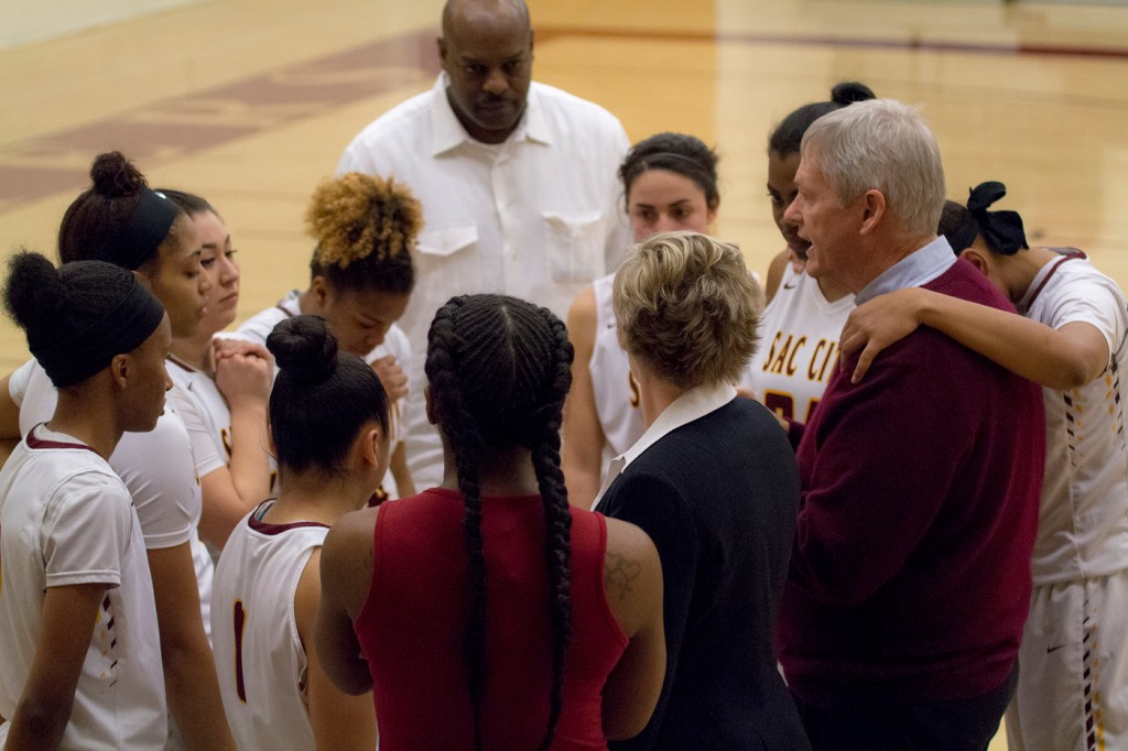 Assistant Coach Bob Roehl talks to the women's basketball team before the start of the second half of the game against Sierra College in the North Gym Jan. 5, 2016. (Photo by: Kristopher Hooks | khooks3825@gmail.com)