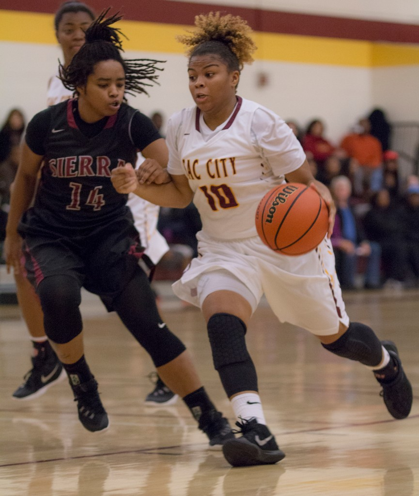 City College point guard Mikaila Royster drives to the basket for a layup during the game against Sierra College in the North Gym Jan. 5, 2016. (Photo by: Kristopher Hooks | khooks3825@gmail.com)