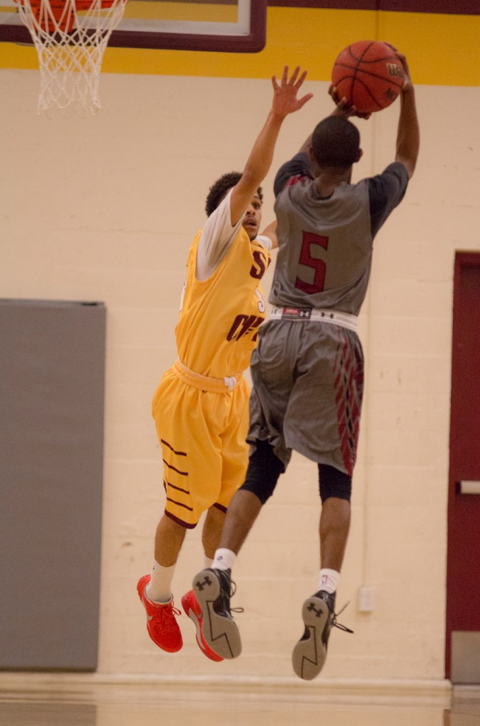 City College guard Devin Joseph contested the shot of Sierra College guard DeAnte Collins during the game against Sierra College in the North Gym Jan. 5, 2016. (Photo by: Kristopher Hooks | khooks3825@gmail.com)
