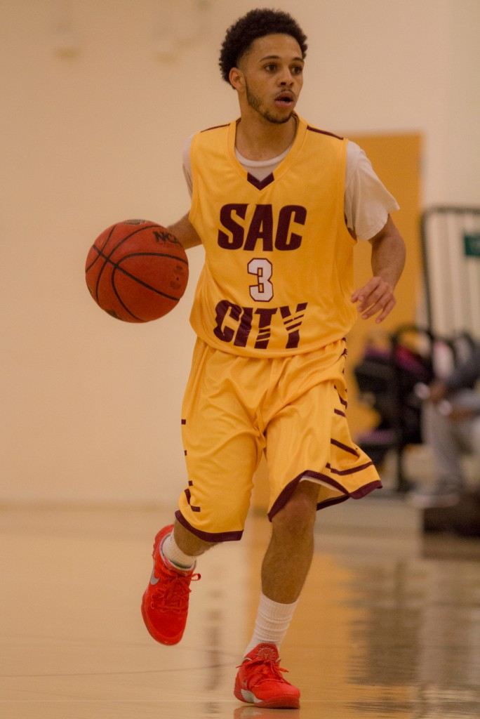 City College guard Devin Joseph dribbles the ball up court during the game against Sierra College in the North Gym Jan. 5, 2016. (Photo by: Kristopher Hooks | khooks3825@gmail.com)