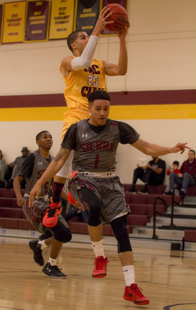 City College forward Vic Rustin goes up for the layup on a fast break and draws a foul during the game against Sierra College in the North Gym Jan. 5, 2016. (Photo by: Kristopher Hooks | khooks3825@gmail.com)