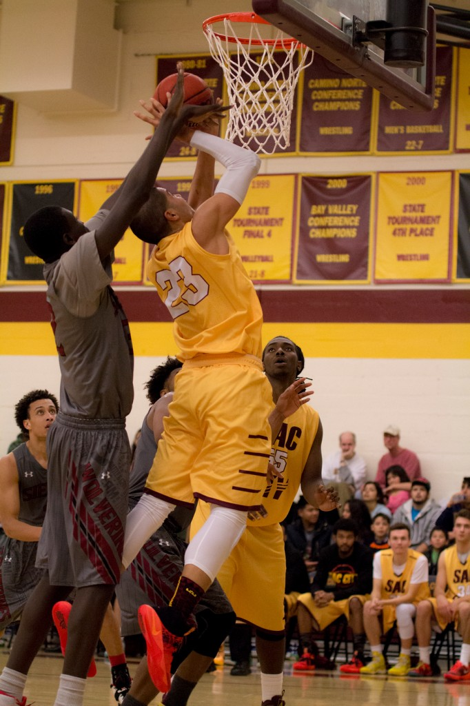 City College forward Vic Rustin goes up for 2 and draws a foul during the game against Sierra College in the North Gym Jan. 5, 2016. (Photo by: Kristopher Hooks | khooks3825@gmail.com)