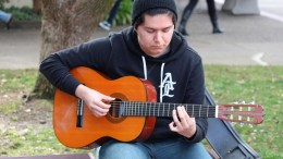 City College student Ivann Fernandez, Marine Biology major, taking a break between his classes to play his guitar in the courtyard on Wednesday, January 20, 2016.