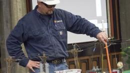 Josh Ehrhardt, SMUD worker, demostrates what happens when a person touches a transformer box. Julie Jorgensen, Photo Editor. | juliejorgensenexpress@gmail.com