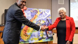 City College Vice President Michael Poindexter at Dr. Jeffery with Dr. Jeffery in front of a reproduction artwork for her at her reception on Thursday afternoon Jan. 28, 2016 Barbara Williams, staff photgrapher. | BarbarajExpress@gmail.com