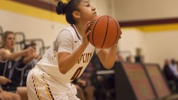 Corina Tacardon, City College sophomore point guard shoots a three pointer in the first half of the game against Modesto College in the North Gym on Feb. 2nd.  Photos by Dianne Rose