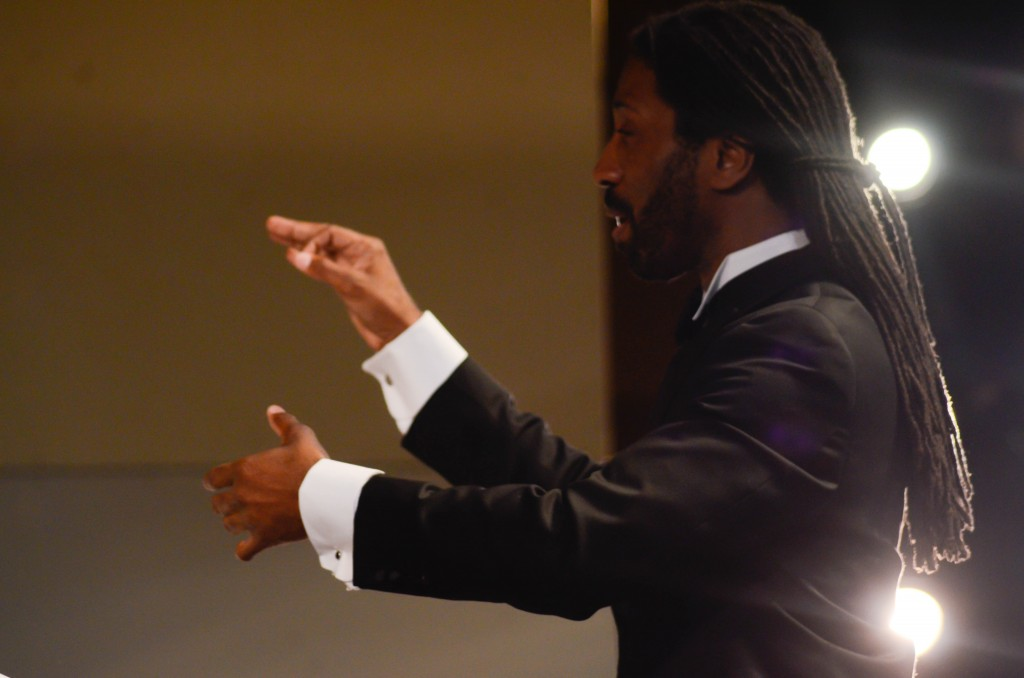 Cosumnes River College conductor Omari Tau directing the Cosumnes River College chamber singers. Christopher Williams, Staff Photographer. |chrisWexpress@gmail.com