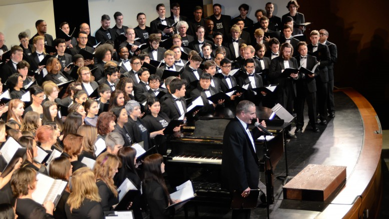 Folsom Lake College Conductor David Newnham directing choir memebers from all the colleges.  Christopher Williams, Staff Photographer.|chrisWexpress@gmail.com