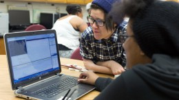City College student Lydia Tran, computer engineering major, watches Keondra Terry, computer engineering major, playing a Tran coded computer game at MESA in the Rodda South building. Hector Flores, Staff Photographer. | hectorfloresexpress@gmail.com