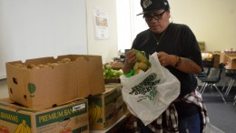 RISE staff member Nyla Vaivai is bagging potatoes for Candice Phillips, art major, as she is getting bags of food items that are offered as a part of the RISE weekly food distribution held at City College April 6, 2016. Barbara Williams, Staff Photographer. | BarbarajExpress@gmail.com