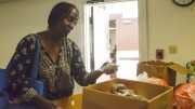 City College student Vicky Davis bags cookies that are offered as a part of the RISE weekly food distribution. Barbara Williams, Staff Photographer. | BarbarajExpress@gmail.com