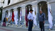 Dave Toler (left), a San Pasqual reservation counselor talks with Bill Gollnick, a tribal administrator for the Tejon tribe, at the 2016 Native American Day event. Behind them, flags of California tribes placed on the west steps of the State Capitol. Sept. 23, 2016. Corey Browning | Staff Photographer | coreybrowningexpress@gmail.com